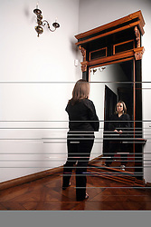 Woman looking in a mirror. (Photo by Vid Ponikvar / Sportal Images)