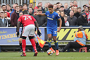 AFC Wimbledon striker Lyle Taylor (33) taking on Charlton Athletic defender Naby Sarr (23) during the The FA Cup match between AFC Wimbledon and Charlton Athletic at the Cherry Red Records Stadium, Kingston, England on 3 December 2017. Photo by Matthew Redman.