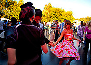 Dancers on the Jive Stage and al fresco ballroom jiving during a jam-packed weekend of swing, jive and lindy hop for the Thames Festival, an autumn weekend celebration each September on the banks of the river Thames