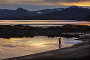 Cooper Antone, 12, wades through the salt water pond on Friday, Nov. 27, 2020 during a sunset at Rotary Beach Park in Ketchikan, Alaska.