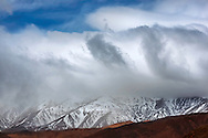 High Atlas Mountains with snow and morning fog, Morocco.