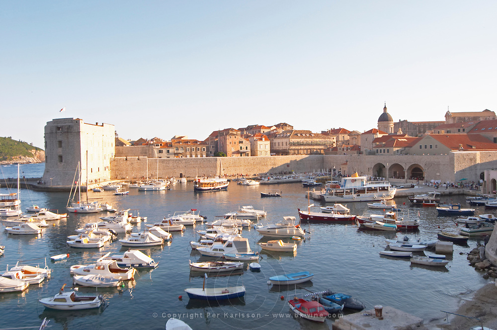 The old harbour with small fishing and pleasure boats. The Arsenal and the Saint John's fortress. Dubrovnik, old city. Dalmatian Coast, Croatia, Europe.