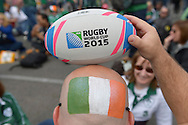 an Ireland fan with a painted Ireland flag holding an official match ball on his bald head outside Wembley before k/o. Rugby World Cup 2015 pool D match, Ireland v Romania at Wembley Stadium in London on Sunday 27th September 2015.<br /> pic by John Patrick Fletcher, Andrew Orchard sports photography.
