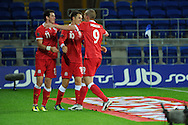 Wales players celebrate after Aaron Ramsey (c) scores his sides 2nd goal. Euro 2012 Qualifying match, Wales v Montenegro at the Cardiff City Stadium in Cardiff  on Friday 2nd Sept 2011. Pic By  Andrew Orchard, Andrew Orchard sports photography,
