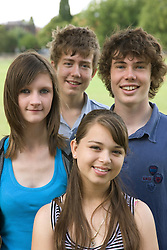 Group of teenagers sitting in the park,