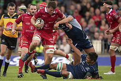 September 22, 2018 - Galway, Ireland - Ed Kennedy of Scarlets tackled by Dave Heffernan and Jarrad Butler of Connacht during the Guinness PRO14 match between Connacht Rugby and Scarlets at the Sportsground in Galway, Ireland on September 22, 2018  (Credit Image: © Andrew Surma/NurPhoto/ZUMA Press)