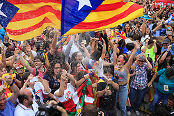 """People wave """"estelada"""" or pro-independence flags, outside the Palau de la Generalitat in Barcelona, Spain, on Friday, October 27, 2017, after Catalonia's regional Parliament passed a motion it says establishes an independent Catalan Republic. Photo by Almagro/ABACAPRESS.COM"""