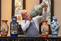 The Bonhams Asian Art Sale takes place on Thursday 15 November at 22 Queen Street Edinburgh starting at 11 am. It features Japanese and Chinese Art including: bronzes, jades, snuff bottles, porcelain, textiles, lacquer, paintings and furniture.<br /> <br /> Pictured: Danny McIlwraith of Bonhams examining a Famille Rose Vase