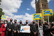 Representatives of the British Airline Pilots Association BALPA stand outside the Houses of Parliament during a day of action by the UKs travel industry to apply pressure on the government to reopen the travel sector and to give financial support to travel businesses on 23rd June 2021 in London, United Kingdom. Pilots, cabin crew and travel agents accused the government of failing to restart travel by undermining its Covid-19 traffic light system, which currently does not include viable major tourist destinations on the quarantine-free green list.