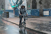A cyclist travels across Tower Bridge during a heavy snow shower on December 10th, 2017. Much of the UK has been hit by heavy snow and The Met Office have issued a yellow weather warning for snow and ice across most of the United Kingdom.