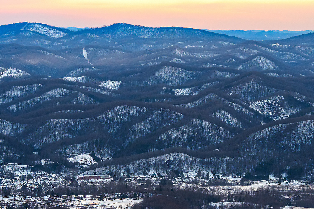The town of Parsons lies below the undulations of snow covered West Virginia mountains.