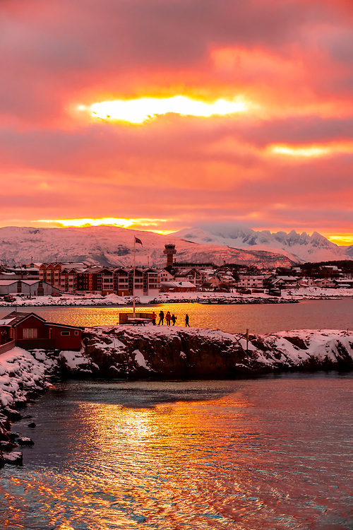 People along the harbor watching the Hurtigruten coastal ship come in to port. Bodo, Arctic Northern Norway.