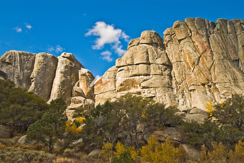 Idaho, Autumn in Cassia County. Climbing at the City of Rocks National Reserve, a popular camping and rock climbing recreational area.