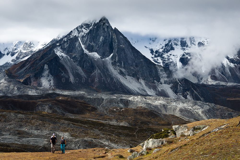 In the Nepal Himalaya, hikers ascend Chhukung Ri (5550 m) with Ama Dablam in the background. Photo © robertvansluis.com
