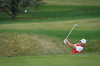 Bergen Catholic's Erick Alonso hits out  of the sand trap at the 5th hole. The Blue Devil Invitational boys golf tournament was held at Echo Lake Country Club in Westfield today, Monday, April, 14, 2014. /Russ DeSantis/For The Star Ledger