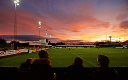 RHYL, WALES - Wednesday, November 14, 2018: Red skies over the Belle Vue Stadium as Wales supporters watch the pre-match warm-up before the UEFA Under-19 Championship 2019 Qualifying Group 4 match between Wales and Scotland. (Pic by Paul Greenwood/Propaganda)