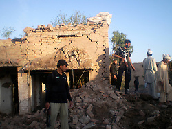59614223  .Police stand guard at the blast site in northwest Pakistan s Bannu, May 8, 2013. At least two were killed and 27 others injured when a suicide car bomb hit a police station in Pakistan s northwest Bannu district on Wednesday morning, reported local media, May 8, 2013. Photo by:  imago / i-Images.UK ONLY