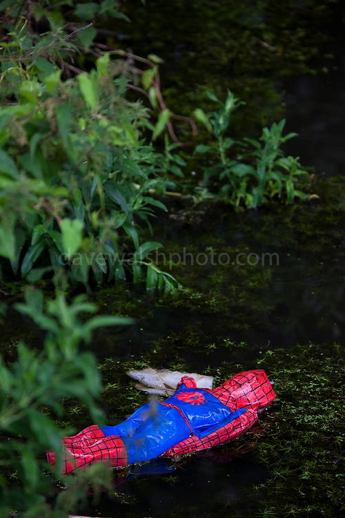 """Dead spiderman, facedown in a canal, Amsterdam This mage can be licensed via Millennium Images. Contact me for more details, or email mail@milim.com For prints, contact me, or click """"add to cart"""" to some standard print options."""