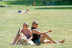 ©Licensed to London News Pictures 21/05/2020<br /> Greenwich, UK. A mother and daughter relax in the park. People out and about in Greenwich park, Greenwich, London this afternoon enjoying lockdown freedom as the mini heatwave hot weather continues  with temperatures set to hit 28C in parts of the UK.  Photo credit: Grant Falvey/LNP