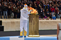 October 31, 2017 - Athens, Attiki, Greece - Last Torchbearer Ioannis Proios is lighting the cauldron. The Handover Ceremony of the Olympic Flame for Winter Games PYEONGCHANG 2018, took place today in Panathenaic Stadium in the presence of the President of Hellenic Republic Prokopis Pavlopoulos. (Credit Image: © Dimitrios Karvountzis/Pacific Press via ZUMA Wire)