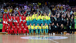 Australia (centre) celebrate with their gold medals, England (left) with their silver medals and New Zealand with their bronze medals after the Women's Gold Medal Game at the Gold Coast Convention and Exhibition Centre during day ten of the 2018 Commonwealth Games in the Gold Coast, Australia.