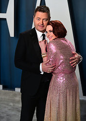 Nick Offerman (left) and Megan Mullally attending the Vanity Fair Oscar Party held at the Wallis Annenberg Center for the Performing Arts in Beverly Hills, Los Angeles, California, USA.