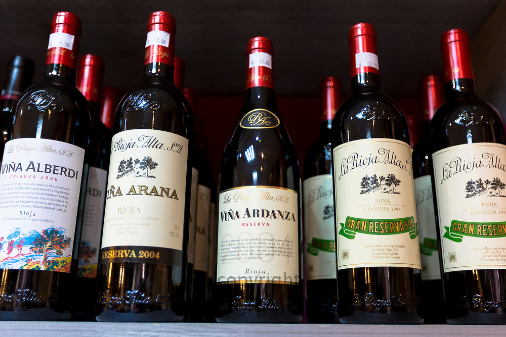 Rioja red wines Vina Alberdi Crianza, Vina Ardanza Reserva, La Rioja Alta Gran Reserva on display in Pepita Uva shop in Laguardia, Rioja-Alavesa, Spain