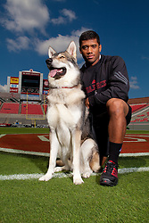 """01 October 2010: North Carolina State Wolfpack quarterback Russell Wilson (16) with the NC State mascot """"Tuffy"""" at Carter-Finley Stadium in Raleigh, NC."""