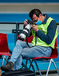 Photographer Soenar Chamid in action during the Dutch Athletics Championships on 14 February 2021 in Apeldoorn