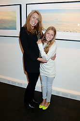 GRANIA STEPHENSON and her daughter CHARIS STEPHENSON at a private view of Photographs by Julian Lennon held at The Little Black Gallery, 13A Park Walk, London SW10 on 17th September 2013.