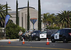 April 28, 2019 - Poway, California, United States - San Diego County Sheriff's deputies stand outside the Chabad of Poway, where a deadly shooting took place the day before on April 28, 2019 in Poway, California. (Credit Image: © KC Alfred/ZUMA Wire)