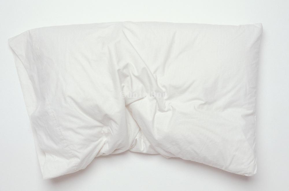 still life of rumpled white pillow