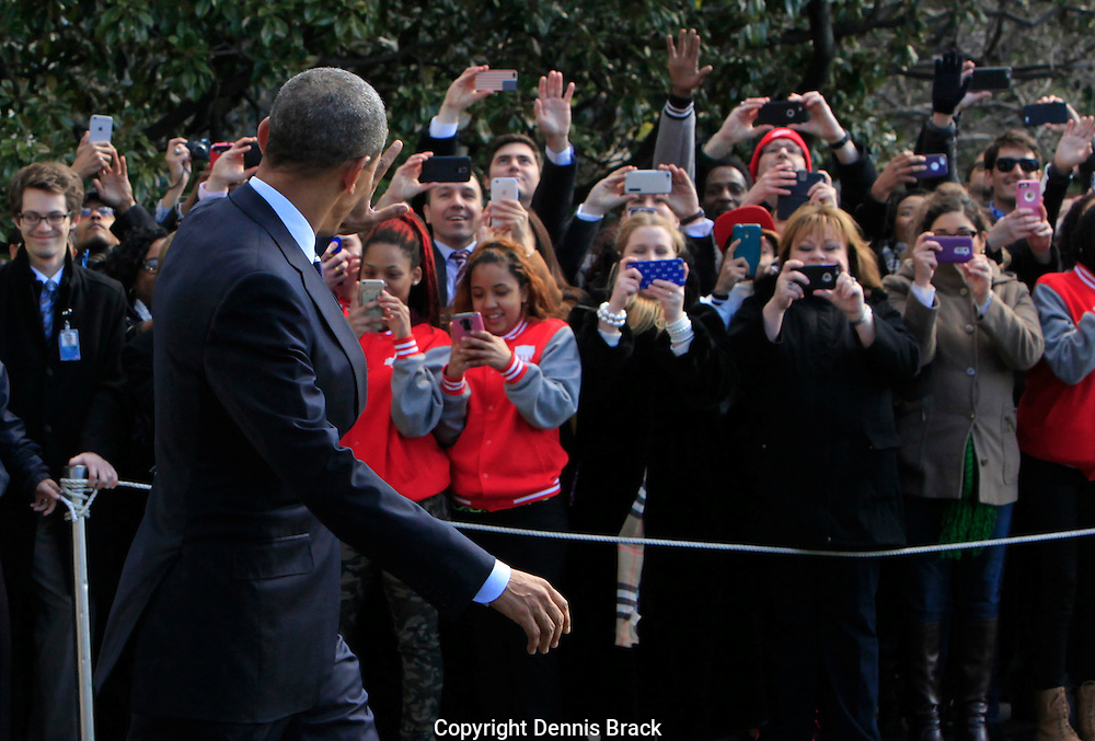 President Barack Obama waves to crowd as he walks to Marine One on the South Lawn of the White House on February 26,2016. photo by Dennis Brack