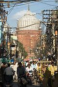 Heavy traffic on the congested streets of Old Delhi looking towards the Jama Masjid, Delhi, India