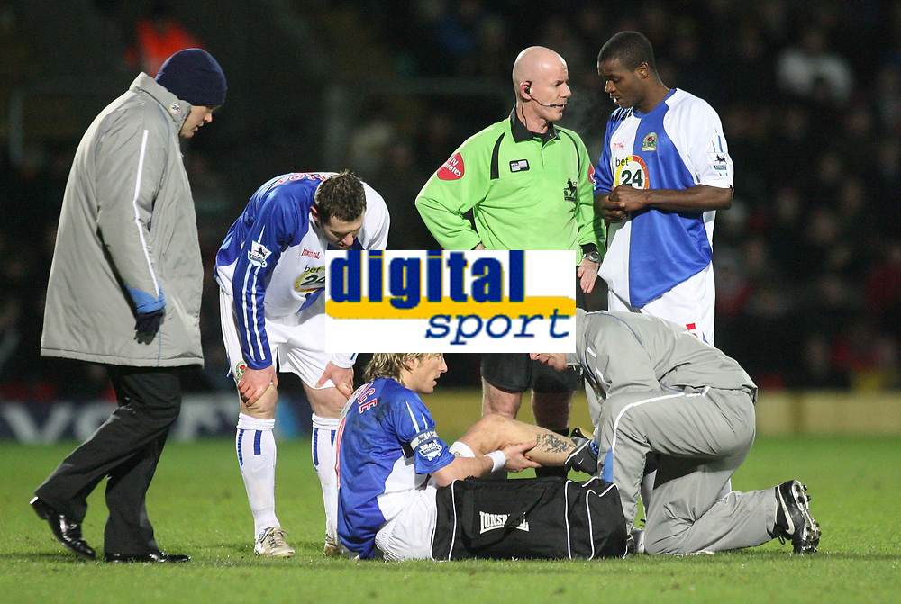 Photo: Marc Atkins.<br /> Watford v Blackburn Rovers. The Barclays Premiership. 23/01/2007. Robbie Savage, (C) receives medical attention as he lays injured after a challenge with Al Bangura (unseen) of Watford. It is later discovered that Savage has suffered a broken leg in the challenge.