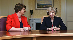 File photo dated 25/7/2016 of Arlene Foster (left), leader of the Democratic Unionist Party, with Prime Minister Theresa May, who will hold critical talks on a deal to prop up a Tory minority administration after the Government admitted the Queen's Speech could be delayed.