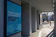 As the number of UK Coronavirus cases rose to over 8,000, it was announced that thousands of 15-minute home tests could be made available within days to those self-isolating with symptoms. A digital billboard tells theatregoers at the Old Vic theatre to take care of themselves, at Waterloo, on 25th March 2020, in London, England.