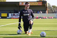 AFC Wimbledon goalkeeper Joe McDonnell (24) warming up during the EFL Sky Bet League 1 match between AFC Wimbledon and Oxford United at the Cherry Red Records Stadium, Kingston, England on 29 September 2018.
