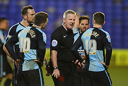 Referee Mark Heywood sends off Wycombe Wanderers's Matt McClure - Photo mandatory by-line: Richard Martin-Roberts/JMP - Mobile: 07966 386802 - 03/03/2015 - SPORT - football - Tranmere - Prenton Park - Tranmere Rovers v Wycombe Wanderers - Sky Bet League Two