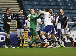 Sheffield Wednesday's Chris Kirkland keeps Atdhe Nuhiu away from Millwall's Stephen Bywater - Photo mandatory by-line: Robin White/JMP - Tel: Mobile: 07966 386802 28/01/2014 - SPORT - FOOTBALL - The Den - Millwall - Millwall v Sheffield Wednesday - Sky Bet Championship