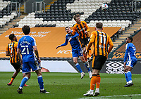 Hull City's Keane Lewis-Potter heads at goal under pressure from Gillingham's Stuart O'Keefe<br /> <br /> Photographer Alex Dodd/CameraSport<br /> <br /> The EFL Sky Bet League One - Hull City v Gillingham - Saturday 27th March 2021 - KCOM Stadium - Kingston upon Hull<br /> <br /> World Copyright © 2021 CameraSport. All rights reserved. 43 Linden Ave. Countesthorpe. Leicester. England. LE8 5PG - Tel: +44 (0) 116 277 4147 - admin@camerasport.com - www.camerasport.com