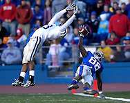 Kansas State defensive back Joshua Moore (L) has an interception goes through his hands as Kansas wide receiver Dexton Fields (88) reaches for the ball in the first half at Memorial Stadium in Lawrence, Kansas, November 18, 2006.  Kansas beat K-State 39-20.<br />