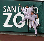The New York Yankees Gary Sheffield (11) collides with center fielder Bubba Crosby while trying to catch a long fly ball by Angels second baseman Adam Kennedy in the bottom of the second inning of their 2005 Playoff game.