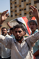 A man shouts his demands for an Islamic state at a Muslim Brotherhood rally in Nassr City, Cairo.