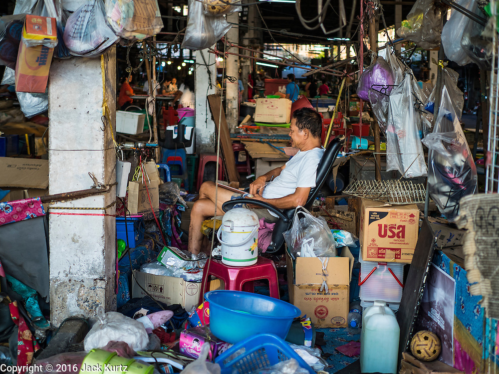 04 JANUARY 2016 - BANGKOK, THAILAND:        A shopkeeper his housewares shop in Bang Chak Market on the last day the market was open. The market closed January 4, 2016. The Bang Chak Market serves the community around Sois 91-97 on Sukhumvit Road in the Bangkok suburbs. About half of the market has been torn down. Bangkok city authorities put up notices in late November that the market would be closed by January 1, 2016 and redevelopment would start shortly after that. Market vendors said condominiums are being built on the land.     PHOTO BY JACK KURTZ