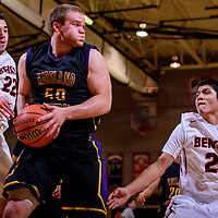 010815       Cable Hoover<br /> <br /> Kirtland Central Bronco Isaac Decker (50) holds off Gallup Bengals Richard Rangel (22) and Ronald Lee (20) during the Gallup Boys Invitational at Gallup High School Thursday.
