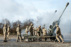 Royal Artillery gun crew firing an L118 105mm light gun during exercise Steel Sabre. A large Scale military live fire exercise on Otterburn Training Area it involves 1400 troops the majority from the Royal Artillery 1st Artillery Brigade and brings all the components of an effective Artillery group together to train in delivering firepower on the battlefield.<br /> <br />   02 March 2017 <br />   Copyright Paul David Drabble<br />   www.pauldaviddrabble.co.uk