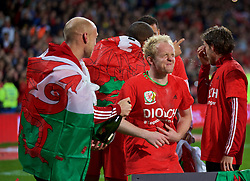 CARDIFF, WALES - Tuesday, October 13, 2015: Wales' David Cotterill and Jonathan Williams celebrate qualifying for the finals after the 2-0 victory over Andorra during the UEFA Euro 2016 qualifying Group B match at the Cardiff City Stadium. (Pic by Barry Coombs/Propaganda)