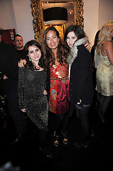 Centre, JADE JAGGER and her daughters, left ASSISI JACKSON anr right AMBA JACKSON at the opening of Jade Jagger's shop at 43 All Saints Road, London W11 on 25th November 2009.