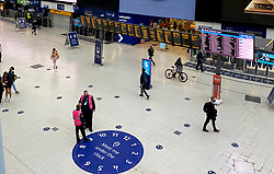 © Licensed to London News Pictures. 23/10/2020. London, UK. A quiet Waterloo Station at the start of the half term holiday. Normally, the station would be busy with travellers. However, due to London being in COVID-19 tier two restrictions, and local and regional areas in tier three, commuters are travelling less as the government has imposed tougher measures to manage increasing cases. Photo credit: Dinendra Haria/LNP
